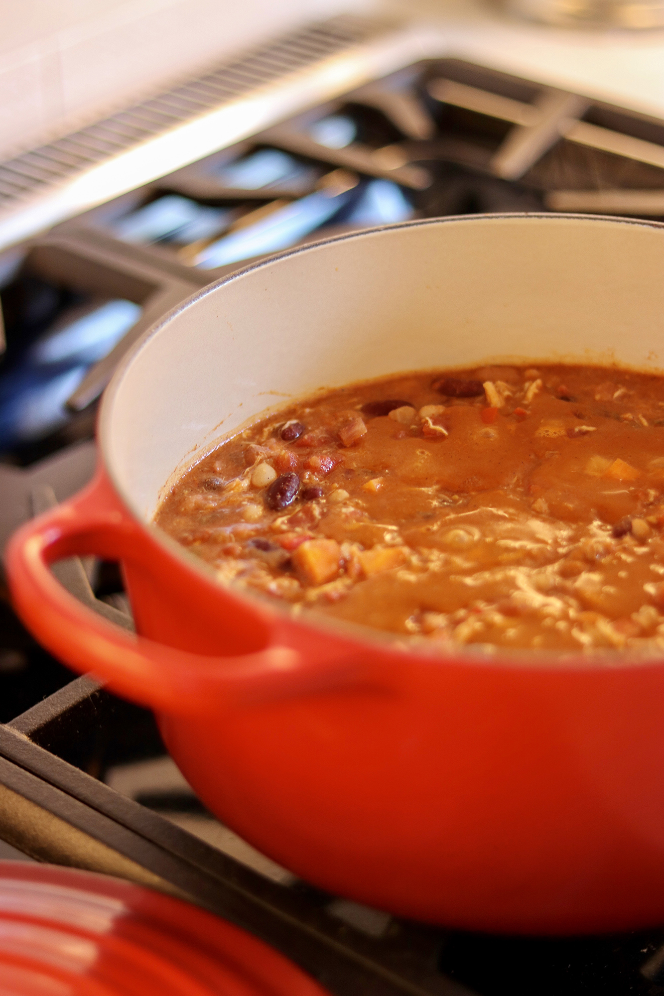 Delicious 3-Bean Chicken Chili Recipe for those cozy Fall/Winter nights in. The best weeknight dinner recipe for families!