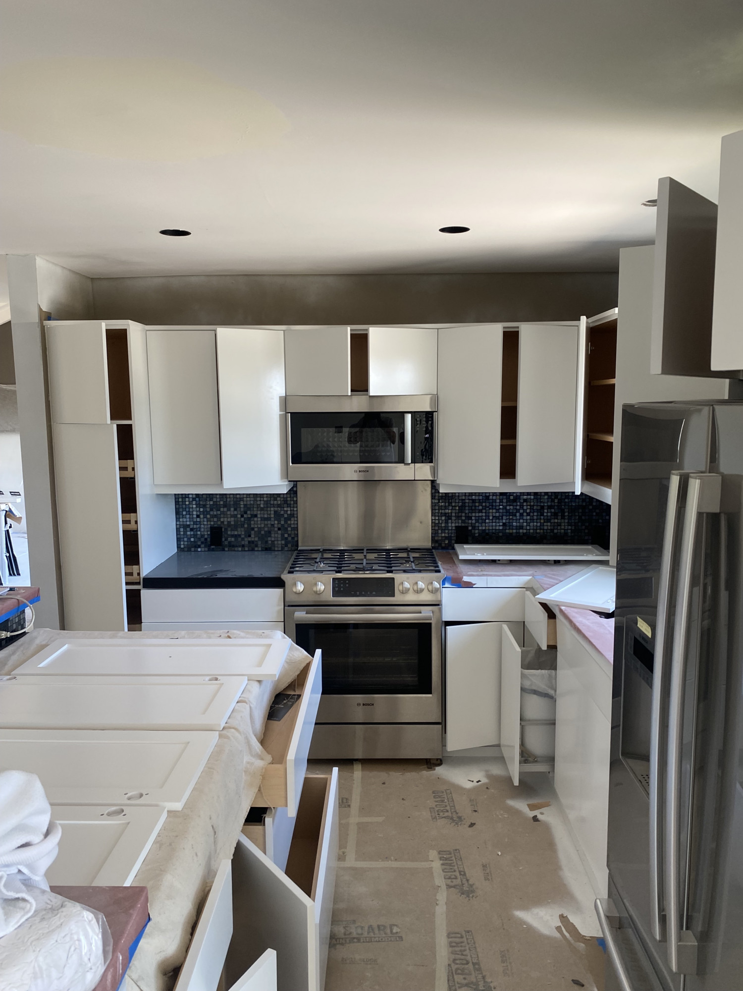 Painting my kitchen cabinets & tile - perfect budget friendly renovation option. We share our paint color options and more about our future plans